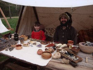 A Viking Merchant and his son travel with the warriors and display goods found at Viking sites.